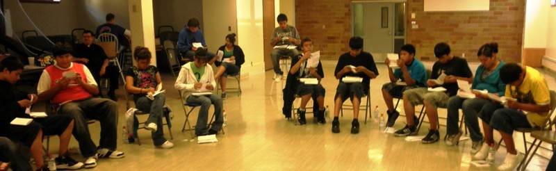 Lakota youth reading letters at St. Joseph's retreat