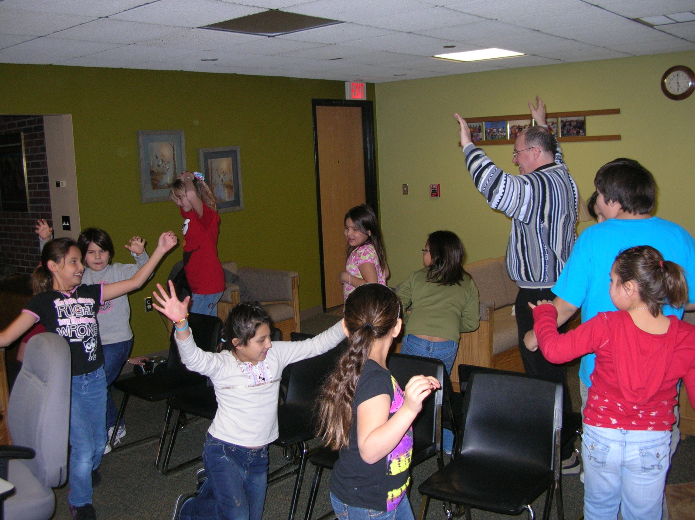 Fr. Steve and some Native American children play musical chairs!