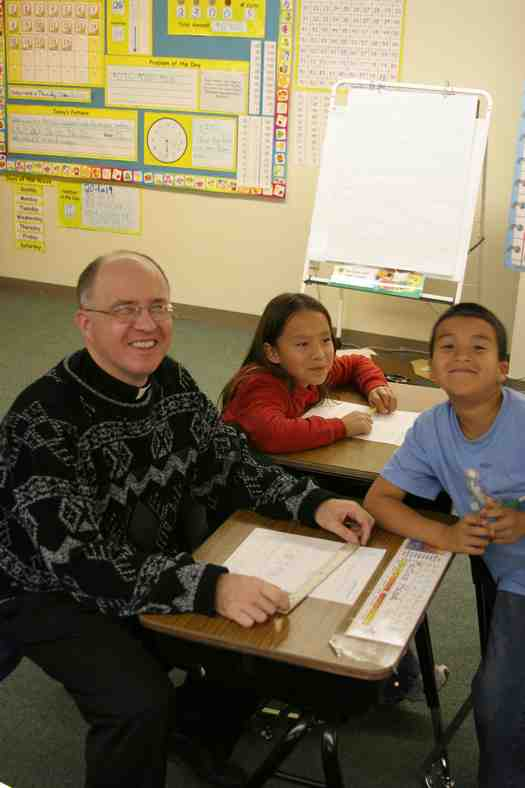 Fr. Steve in the classroom with our Native American students.