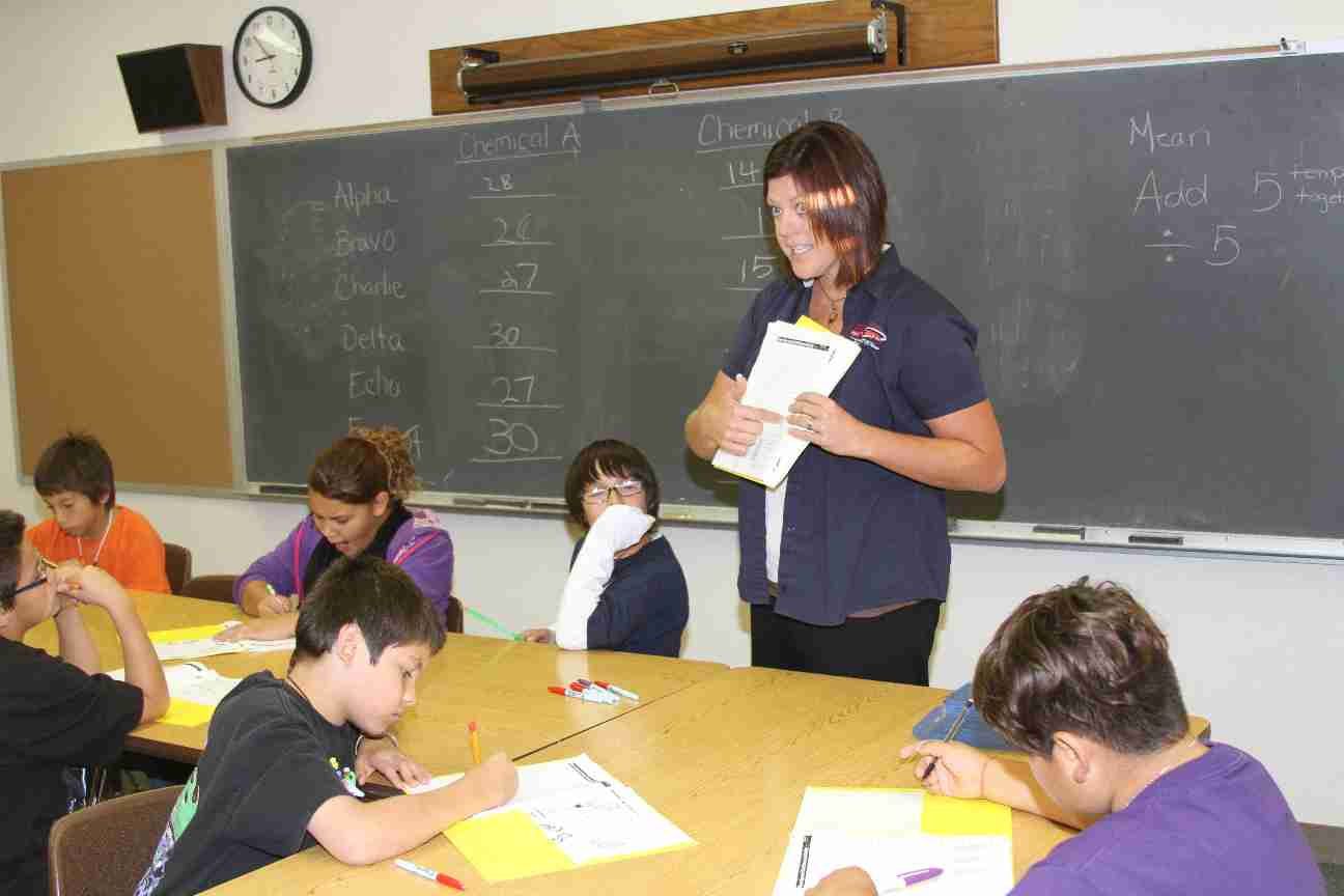 A teacher lecturing in her classroom.