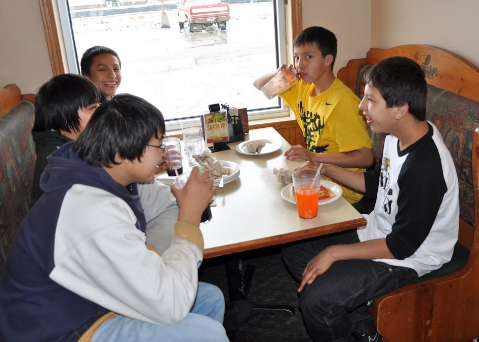 Native American boys eating at Pizza Ranch.