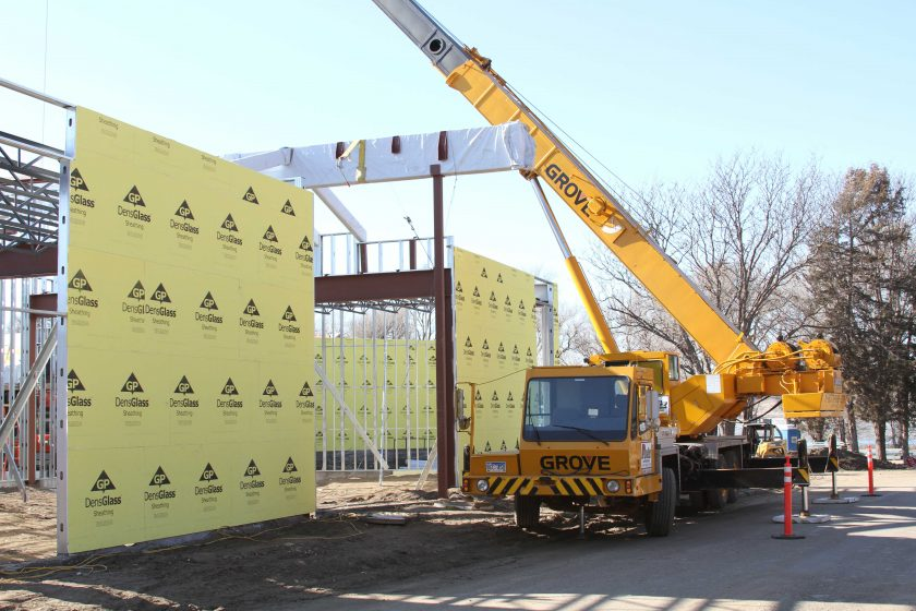February 2012 – Glulam beams are set as work on the roof begins.