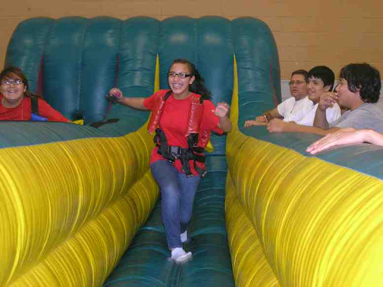 Native American students race each other on the bungee run during Red Ribbon Week.