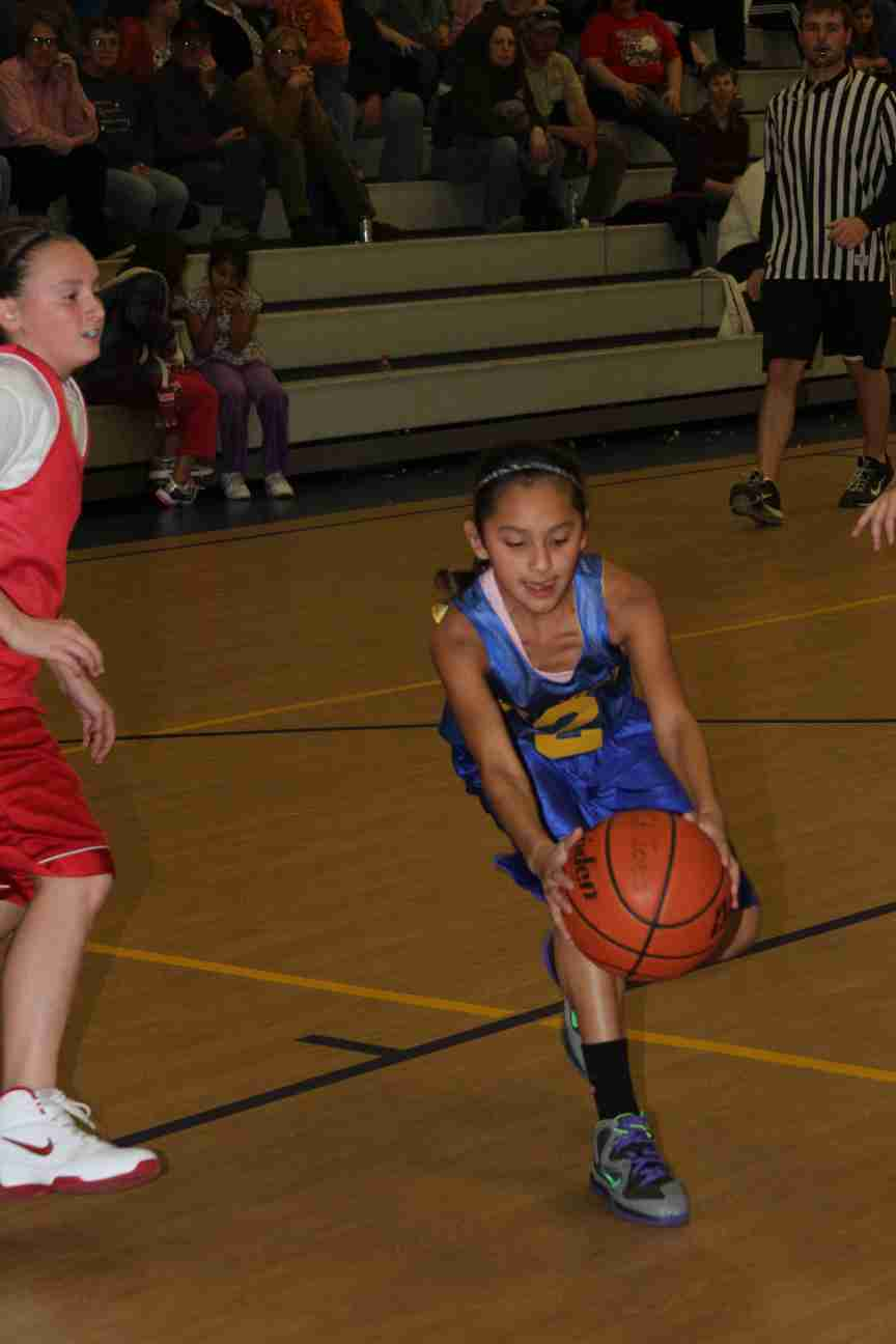 Kira grabs a loose ball in her last basketball game!