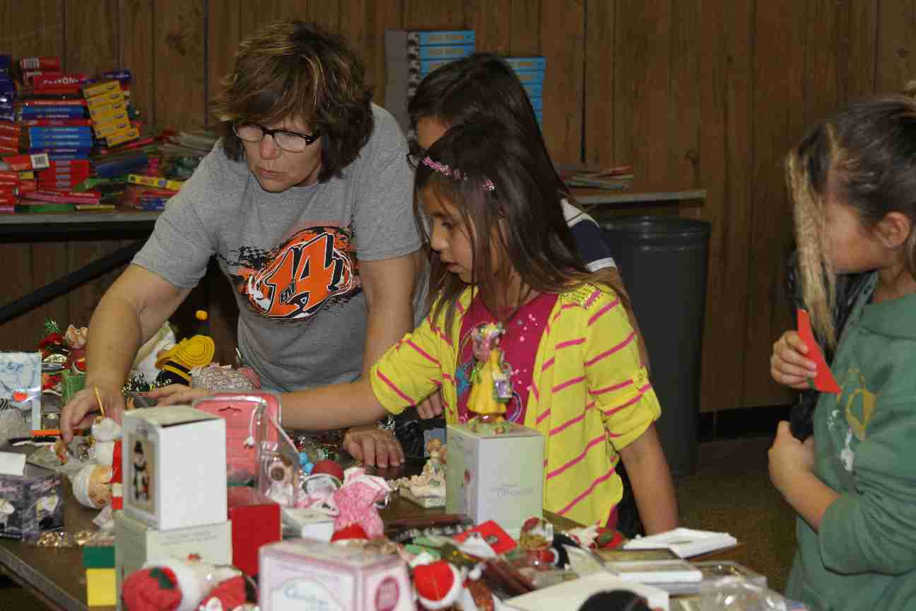 Houseparents help students choose gifts for their families.