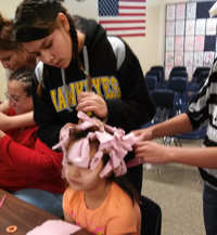 The older Lakota girls fixed hair for the younger girls.
