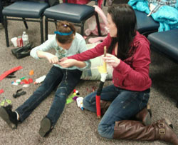 Craft projects help make the day enjoyable and relaxing for the Lakota children.