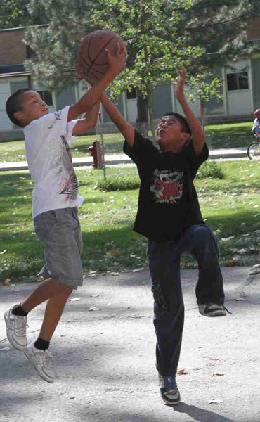 Shooting hoops after school is a favorite pastime of the Lakota boys and girls at St. Joseph's.