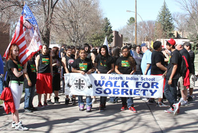 Native American families joined their students for St. Joseph's Sobriety Walk.
