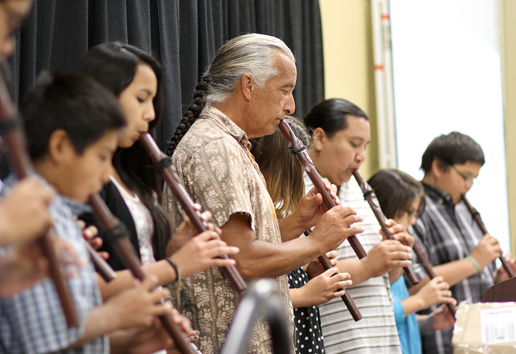The Lakota children joined Kevin Locke in a flute recital.