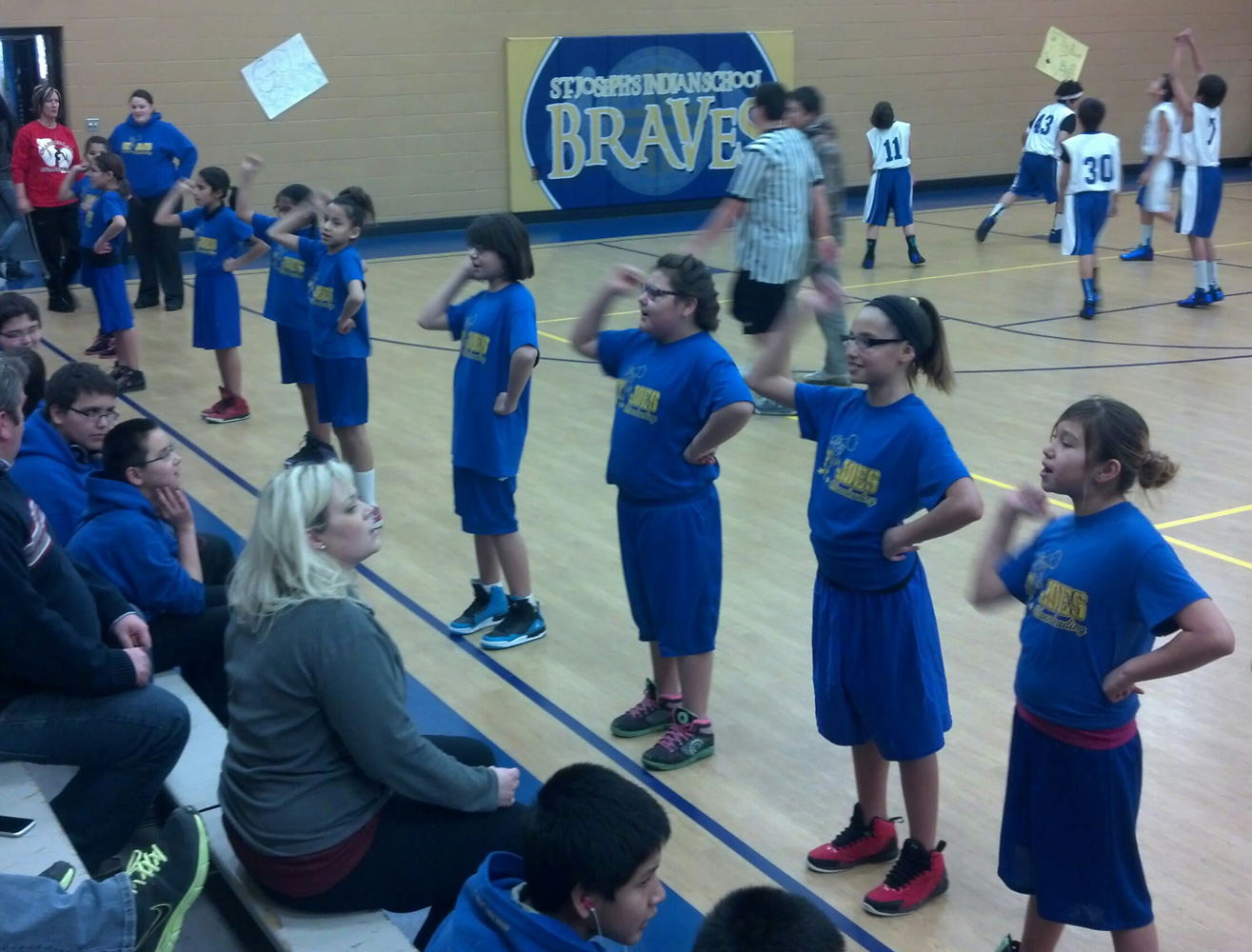 St. Joseph's students participate in all kinds of sports, including basketball and cheerleading, at our rec center.