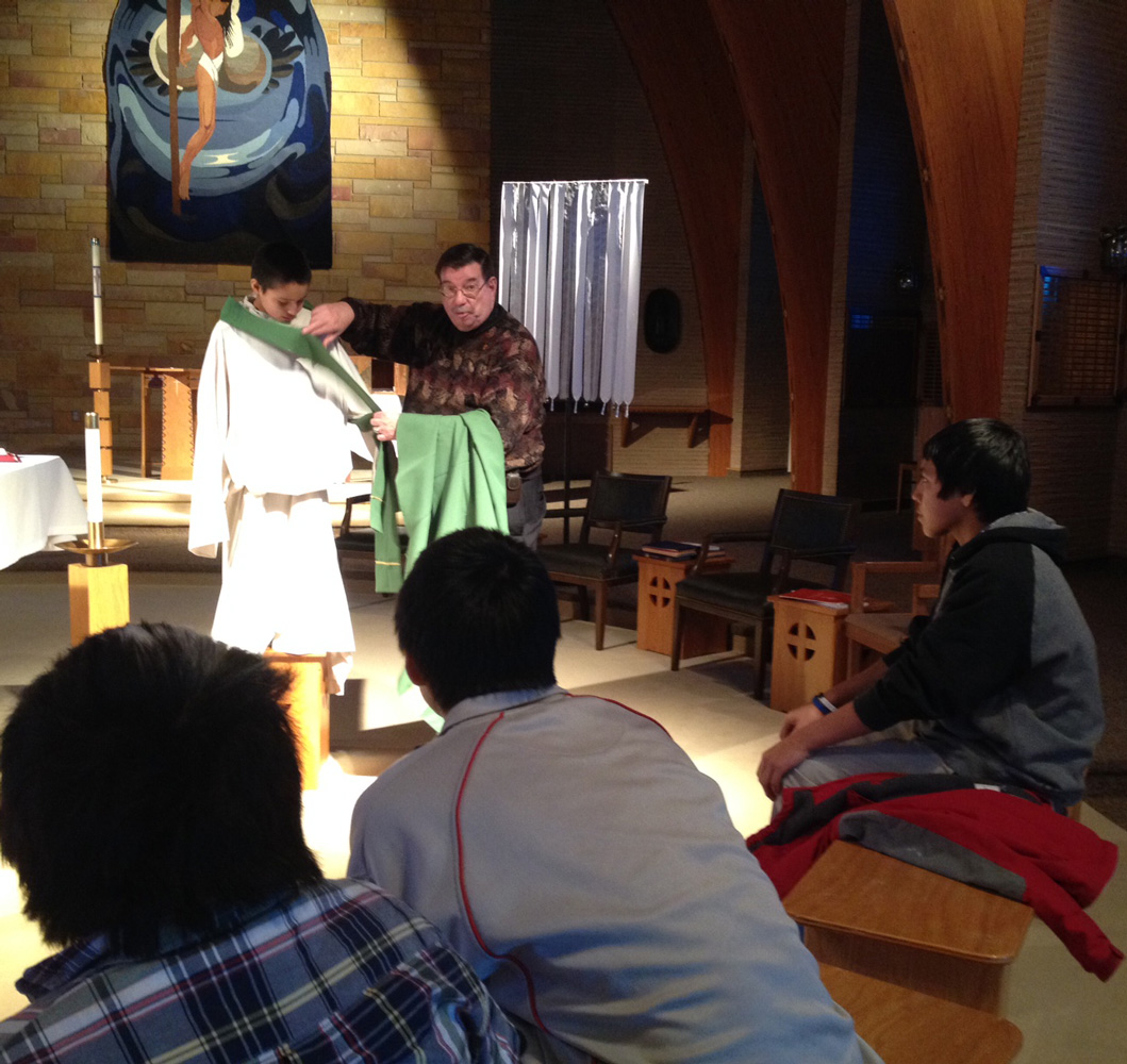 Fr. Anthony, St. Joseph's Chaplain, shares with the Lakota children during Sacramental Preparation.