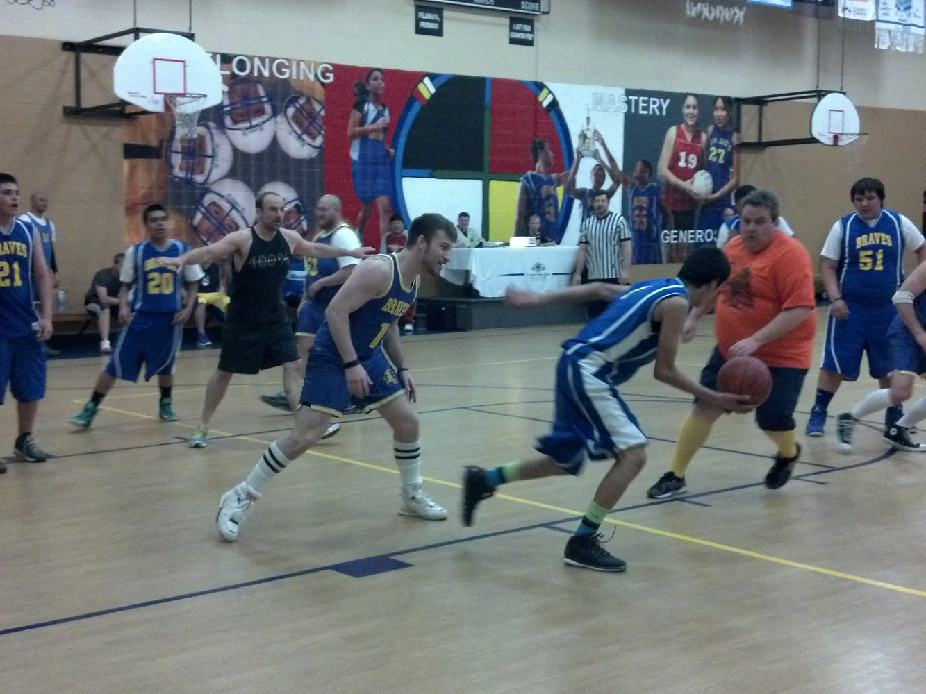 St. Joseph's eighth grade boys matched up against staff for a basketball game.