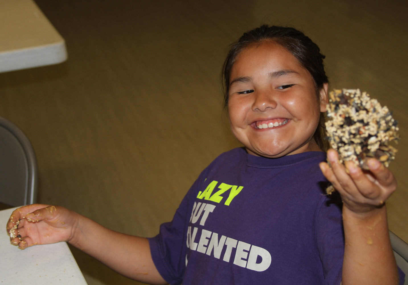 The Lakota children learned to make birdfeeders with pinecones and peanut butter.
