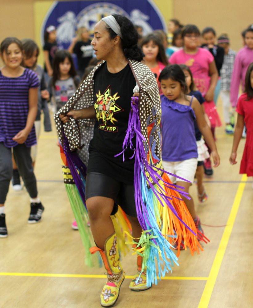 St. Joseph's has many Native American houseparents like Rachel, who teaches students about powwow dances.