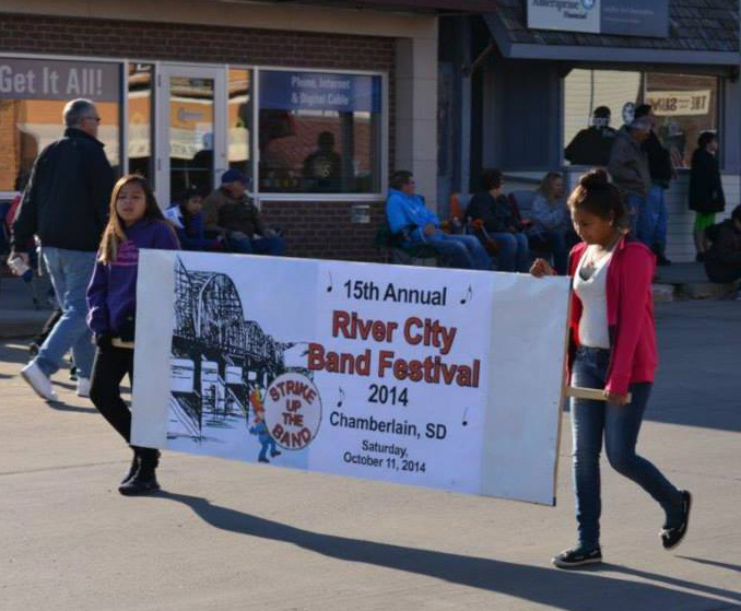 The Lakota boys and girls participated in the parade for the River City Band Festival in Chamberlain.
