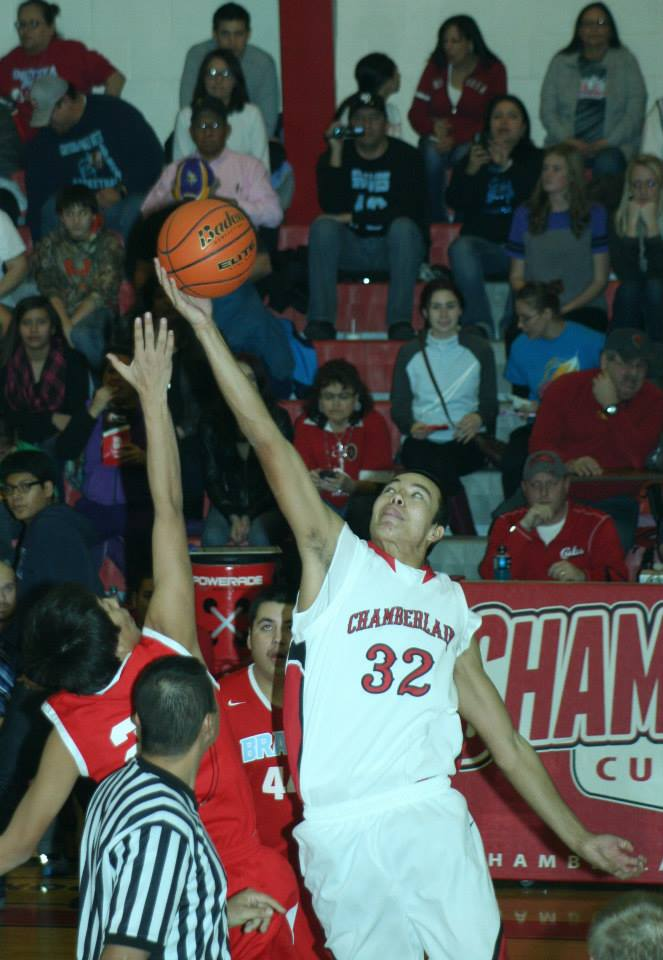 Adrian, a St. Joseph's junior, works hard on the Chamberlain high school basketball team.