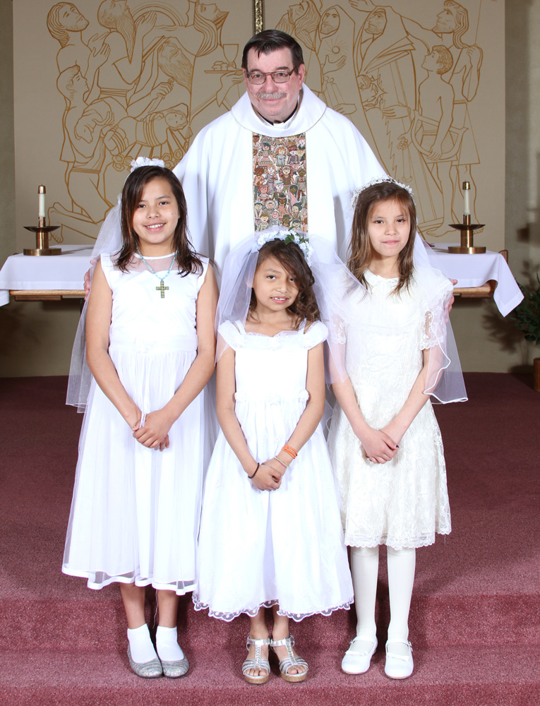 Fr. Anthony and the Lakota children.