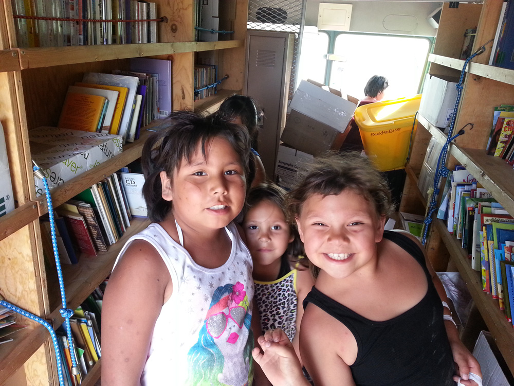 Lakota (Sioux) children choose books to take home.