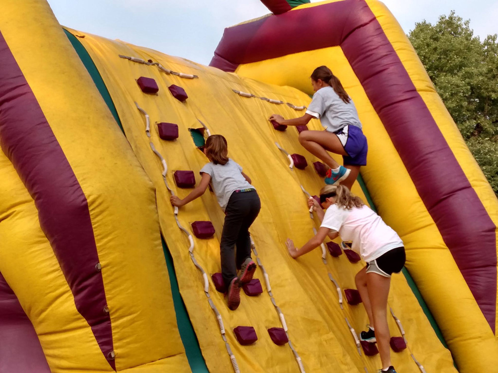 Participants had to run the obstacle course, climbing over, under or through various inflatables.