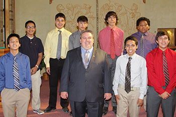 Frank and the boys who graduated from eighth grade in 2017 are pictured in their shirts and ties for the event.