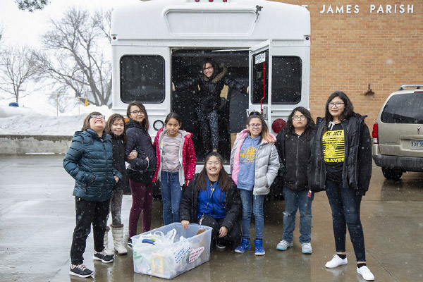 Some fourth through sixth grade students took a donation of food to a local food pantry.