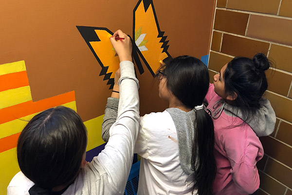 St. Joseph's student painting a mural.